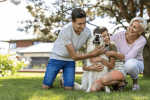 Family members playing with their dog and enjoying their poop free lawn in Denver, Colorado.
